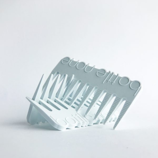 three white Bottle None recycled plastic combs stacked on top of each other on a white background